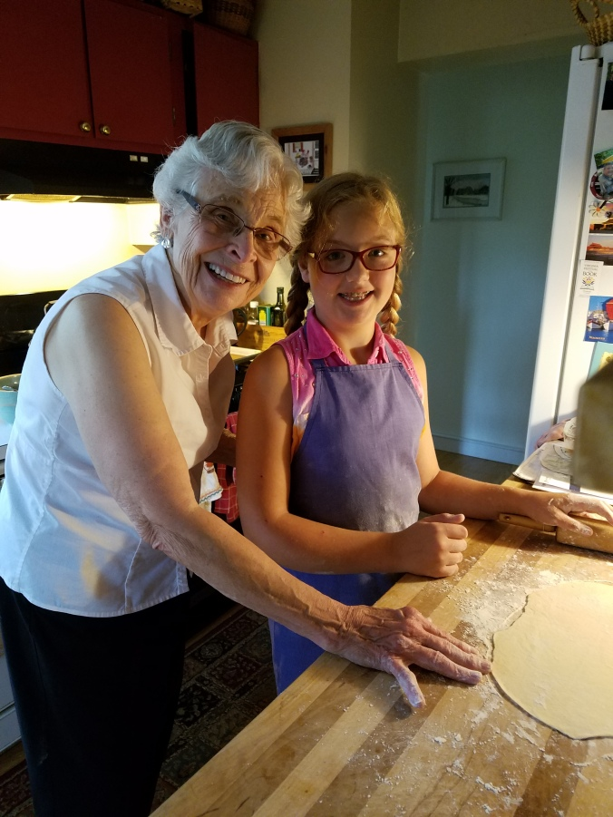 Mom and Kaileena rolling out dough