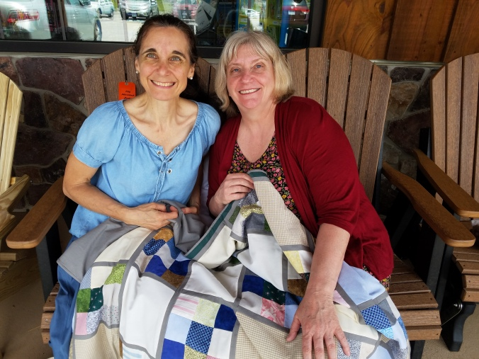 Kim and I with lapquilt.jpg